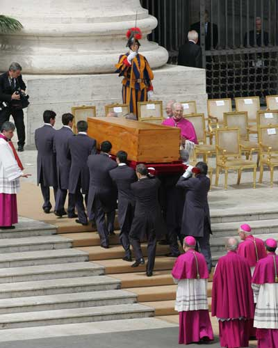 "<div class=""meta ""><span class=""caption-text "">Pope John Paul II's coffin is carried away from St. Peter's Square after the funeral service on its way to the grottos beneath St. Peter's Basilica, at the Vatican, Friday, April 8, 2005. The grottos form a cramped underground cemetery beneath St. Peter's Basilica where pontiffs throughout the ages, royals and even an emperor have been laid to rest.  (AP Photo/Diether Endlicher)</span></div>"